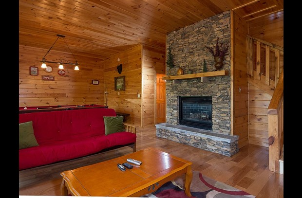 Lower living/Game Room,Stacked Stone Gas Fireplace, 55 in HDTV,Full Size Futon
